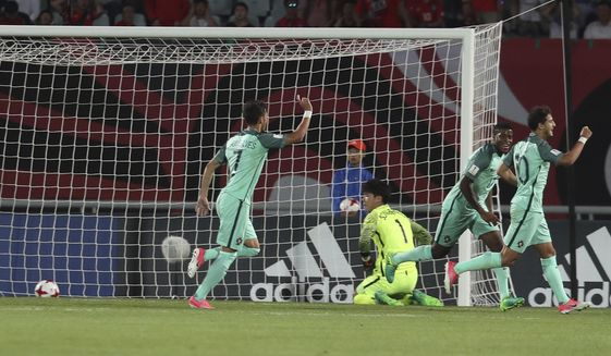Portugal's Xadas, right, celebrates his goal after scoring against South Korea during the round of 16 soccer match between South Korea and Portugal in the FIFA U-20 World Cup Korea 2017 at Cheonan Sports Complex in Cheonan, South Korea, Tuesday, May 30, 2017. (Park Dong-ju/Yonhap via AP)