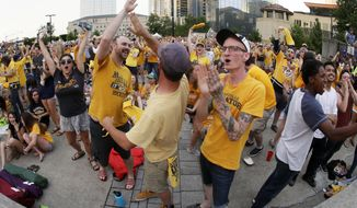 Nashville Predators fans cheer as they watch Game 1 of the NHL Stanley Cup Finals at one of several viewing areas set up Monday, May 29, 2017, in Nashville, Tenn. The Predators are facing the Pittsburgh Penguins. (AP Photo/Mark Humphrey)
