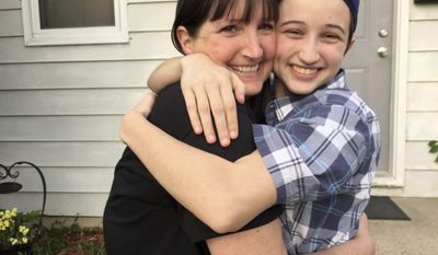 In this undated photo provided by the Transgender Law Center, Ashton Whitaker, right hugs his mom Melissa in Kenosha, Wisc. A federal appeals court says Ashton, a transgender senior student, who identifies as a male, should be able to use the boys' bathroom at at Kenosha's Tremper High School. (Transgender Law Center via AP)