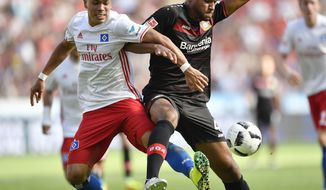FILE - In this Saturday, Sept. 10, 2016 file photo, Hamburg's Bobby Wood, left, and Leverkusen's Jonathan Tah challenge for the ball during the German Bundesliga soccer match between Bayer Leverkusen and Hamburger SV in Leverkusen, Germany,  His balky back feeling better, forward Bobby Wood helped his club team, Hamburger SV, avoid being sent down a level in the Bundesliga with a late-season win. Now, the goal scorer from Hawaii will try to spark the U.S. as the squad resumes the final round of World Cup qualifying.(AP Photo/Martin Meissner, File)