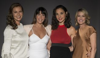 """In this May 20, 2017 photo, Connie Nielsen, from left, director Patty Jenkins, Gal Gadot, and Robin Wright pose for a portrait at the """"Wonder Woman"""" junket in Culver City, Calif. (Photo by Ron Eshel/Invision/AP)"""