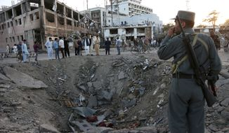 A crater was created by a massive explosion in front of the German Embassy in Kabul, Afghanistan, Wednesday. The suicide truck bomb hit a highly secure diplomatic area of Kabul, killing scores of people and wounding hundreds more. The Chinese, Turkish and Japanese embassies were also damaged. (Associated Press)