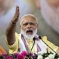 """Indian Prime Minister Narendra Modi marked the 100th anniversary of Gandhi's first campaign against British rule in colonial India by linking it to his """"Clean India"""" campaign. (Associated Press)"""