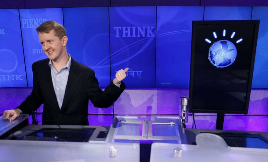 """""""Jeopardy!"""" contest Ken Jennings, who won a record 74 consecutive games, refers to his opponent, an IBM computer called """"Watson"""", while being interviewed after a practice round of the """"Jeopardy!"""" quiz show in Yorktown Heights, N.Y., Thursday, Jan. 13, 2011. It's the size of 10 refrigerators, and it swallows encyclopedias whole, but an IBM computer was lacking one thing it needed to battle the greatest champions from the """"Jeopardy!"""" quiz TV show - it couldn't hit a buzzer. But that's been fixed, and on Thursday the hardware and software system named Watson played a competitive practice round against two champions. A """"Jeopardy!"""" show featuring the computer will air in mid-February, 2011. (AP Photo/Seth Wenig)"""