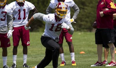 In this May 14, 2016, file photo, Washington Redskins wide receiver Josh Doctson, 18, works out during NFL football rookie minicamp in Ashburn, Va. (AP Photo/Jose Luis Magana, File) **FILE**