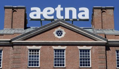 This Aug. 19, 2014, file photo, shows corporate signage at Aetna headquarters in Hartford, Conn. Hartford's Mayor Luke Bronin said Wednesday, May 31, 2017, that he believes Aetna is planning to move its headquarters out of Connecticut. The mayor released a statement saying that he has had multiple conversations with senior leaders at the insurance giant and believes the company decided a long time ago to relocate their corporate headquarters. (AP Photo/Jessica Hill, File)