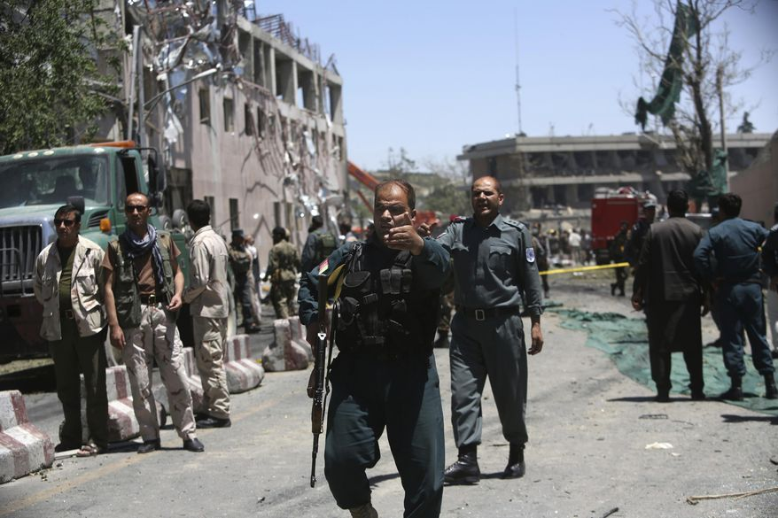 Security forces inspect near the site of a suicide attack where the German Embassy is located in Kabul, Afghanistan, Wednesday, May 31, 2017. A massive explosion rocked a highly secure diplomatic area of Kabul on Wednesday morning, causing casualties and sending a huge plume of smoke over the Afghan capital. (AP Photos/Rahmat Gul)
