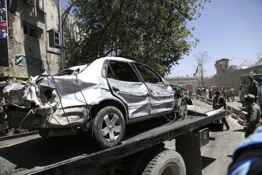 Security forces carry the wreckage of car near the site of a suicide attack where German Embassy is located in Kabul, Afghanistan, Wednesday, May 31, 2017. A massive explosion rocked a highly secure diplomatic area of Kabul on Wednesday morning, causing casualties and sending a huge plume of smoke over the Afghan capital. (AP Photos/Rahmat Gul) ** FILE **