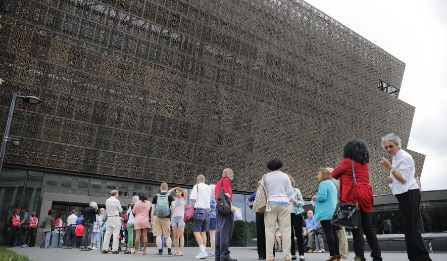 In this May 1, 2017, file photo, people wait in line to enter the Smithsonian National Museum of African American History and Cultural on the National Mall in Washington. Smithsonian Secretary David Skorton said in a statement that a noose was found on Wednesday, May 31, in the Segregation Gallery of the museum. (AP Photo/Pablo Martinez Monsivais) ** FILE **