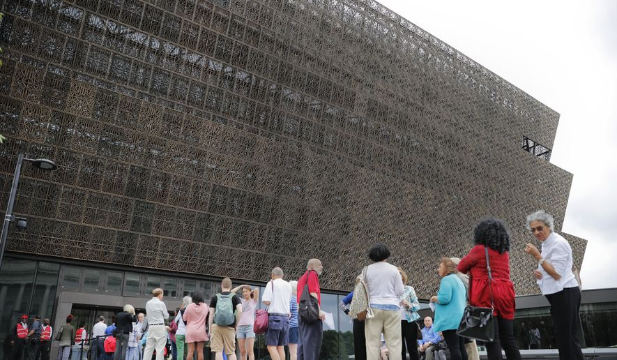 "In this May 1, 2017, file photo, people wait in line to enter the Smithsonian National Museum of African American History and Cultural on the National Mall in Washington. After a firestorm of controversy, the museum has removed a ""whiteness"" graphic that ascribed traits such as ""hard work,"" ""self-reliance,"" ""delayed gratification,"" being on time, and politeness to ""white culture."" (AP Photo/Pablo Martinez Monsivais) ** FILE **"