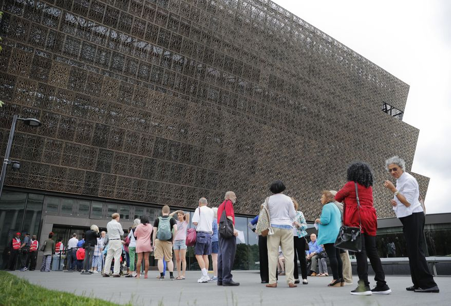 """In this May 1, 2017, file photo, people wait in line to enter the Smithsonian National Museum of African American History and Cultural on the National Mall in Washington. After a firestorm of controversy, the museum has removed a """"whiteness"""" graphic that ascribed traits such as """"hard work,"""" """"self-reliance,"""" """"delayed gratification,"""" being on time, and politeness to """"white culture."""" (AP Photo/Pablo Martinez Monsivais) ** FILE **"""