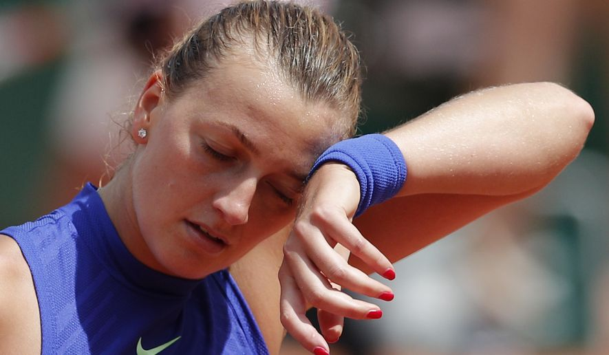 Petra Kvitova of the Czech Republic wipes the seat off her forehead in her second round match against Bethanie Mattek-Sands of the U.S. at the French Open tennis tournament at the Roland Garros stadium, in Paris, France. Wednesday, May 31, 2017. Kvitova lost in two sets 6-7 (5-7), 6-7 (5-7). (AP Photo/Christophe Ena)