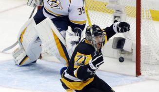 Pittsburgh Penguins' Evgeni Malkin (71) celebrates his goal against Nashville Predators goalie Pekka Rinne (35) during the third period in Game 2 of the NHL hockey Stanley Cup Final, Wednesday, May 31, 2017, in Pittsburgh. (AP Photo/Gene J. Puskar)