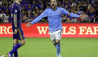 FILE - In this Sunday, May 21, 2017 file photo, New York City FC's David Villa (7) celebrates his second-half goal as he runs past Orlando City's Leo Pereira, left, in an MLS soccer game in Orlando, Fla. (AP Photo/John Raoux, File)