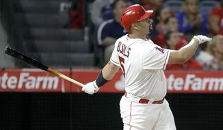 Los Angeles Angels' Albert Pujols watches his three-run home run against the Atlanta Braves during the third inning of a baseball game in Anaheim, Calif., Tuesday, May 30, 2017. Pujols now has 599 career home runs. (AP Photo/Chris Carlson)