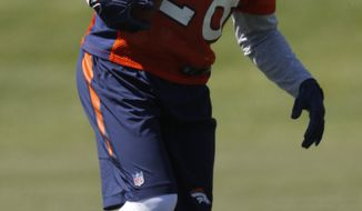 Denver Broncos running back Jamaal Charles stretches as players take part in drills during an NFL football minicamp session at the team's headquarters Tuesday, May 30, 2017, in Englewood, Colo. (AP Photo/David Zalubowski)