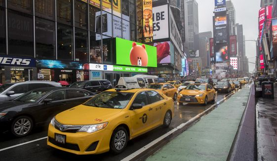 In this Thursday, May 25, 2017, photo, traffic makes it's way down Seventh Avenue in New York's Times Square.  (AP Photo/Mary Altaffer)
