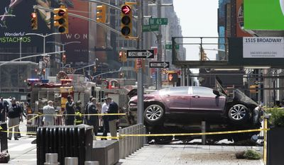 FILE - In this Thursday, May 18, 2017 file photo, a car rests on a security barrier in New York's Times Square after driving through a crowd of pedestrians, injuring at least a dozen people. A three-foot-tall piece of stainless steel in the ground ultimately stopped a speeding Honda Accord as it barreled down the crowded sidewalks of Times Square this week. The vehicle rampage that killed a teenage tourist in New York's Times Square is spurring calls to further restrict cars from the so-called Crossroads of the World. (AP Photo/Mary Altaffer, File)