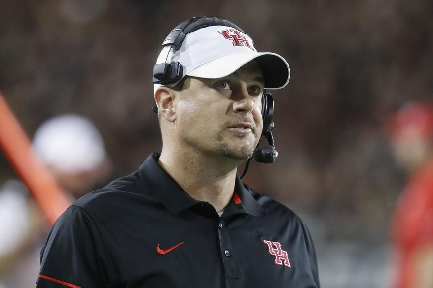 FILE - In this Sept. 15, 2016, file photo, Houston coach Tom Herman stands on the sideline during the first half of an NCAA college football game against Cincinnati in Cincinnati. It is easy to buy into the Herman hype-machine. He very well could be the next great college football coach, and Texas offers him the chance to compete at the highest level. (AP Photo/John Minchillo, File)
