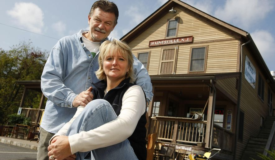 CORRECTS DATE - In this 2008 photo, Hainesville General Store co-owners Megan and Bob Horst pose for a photo outside the store in Sandyston, N.J. It could be the end of an era for one of New Jersey's historic general stores. The owners of the Hainesville General Store in Sussex County are putting it on the market. (Matt Rainey/NJ Advance Media via AP)