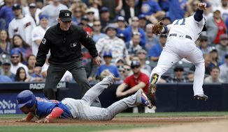 Chicago Cubs' Willson Contreras, left, gets tagged out trying to advance to third by San Diego Padres third baseman Ryan Schimpf, right, as umpire Lance Barksdale watches to make the call during the second inning of a baseball game in San Diego, Wednesday, May 31, 2017. (AP Photo/Alex Gallardo)