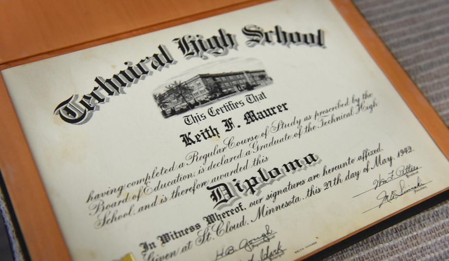 ADVANCE FOR WEEKEND EDITIONS, JUNE 3-4 - In this May 16, 2017 photo, Keith Maurer 1942 graduation certificate from Technical High School is displayed at his home in St. Cloud, Minn. Maurer graduated from Tech in 1942 and served in the U.S. Navy during World War II. (Dave Schwarz/St. Cloud Times via AP)