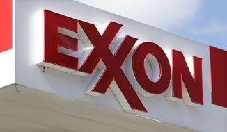 An Exxon service station sign in Nashville, Tenn., is seen here on April 25, 2017. (Associated Press) **FILE**