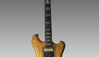"In this undated photo provided by Guernsey's, Jerry Garcia's famous ""Wolf"" guitar is shown. Garcia's custom-made guitar is truckin' to auction in New York City. Guernsey's auction house says it'll be offered Wednesday, May 31, 2017, at Brooklyn Bowl, a bowling alley, restaurant and venue for music shows.  The proceeds will go to the Alabama-based Southern Poverty Law Center. (Guernsey's via AP)"