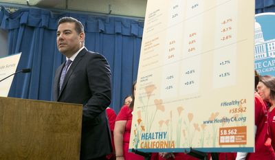 State Sen. Ricardo Lara, D-Bell Gardens, discusses his single-payer health care bill at a Capitol news conference, Wednesday, May 31, 2017, in Sacramento, Calif. (AP Photo/Rich Pedroncelli)