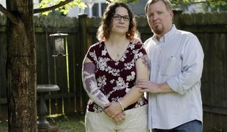 In this May 26, 2017 photo, Lisa Dammert and her husband, Patrick, pose at their home in Franklin, Tenn. As a thyroid cancer survivor battling nerve damage and other complications, Lisa was in such dire financial straits in 2014 that she and her husband let their health insurance lapse, putting them in a category with some 6 million Americans who have gone without coverage at times despite serious health problems. That group and millions of others who have had a gap in insurance could face higher charges under the Republican health care bill that recently passed the House. (AP Photo/Mark Humphrey)