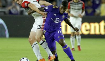 D.C. United's Jared Jeffrey (25) and Orlando City's Carlos Rivas (11) battle for possession of the ball during the first half of an MLS soccer game, Wednesday, May 31, 2017, in Orlando, Fla. (AP Photo/John Raoux)