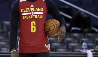 Cleveland Cavaliers' LeBron James holds a ball during an NBA basketball practice, Wednesday, May 31, 2017, in Oakland, Calif. The Cavaliers face the Golden State Warriors in Game 1 of the NBA Finals on Thursday in Oakland. (AP Photo/Marcio Jose Sanchez)