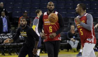 From left, Cleveland Cavaliers' Kyrie Irving, LeBron James and J.R. Smith work on drills during an NBA basketball practice, Wednesday, May 31, 2017, in Oakland, Calif. The Cavaliers face the Golden State Warriors in Game 1 of the NBA Finals on Thursday in Oakland. (AP Photo/Marcio Jose Sanchez)