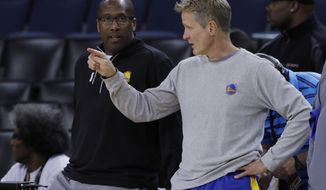Golden State Warriors head coach Steve Kerr, right, talks with interim head coach Mike Brown during an NBA basketball practice, Wednesday, May 31, 2017, in Oakland, Calif. The Golden State Warriors face the Cleveland Cavaliers in Game 1 of the NBA Finals on Thursday in Oakland. (AP Photo/Marcio Jose Sanchez)