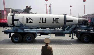 """FILE - In this April 15, 2017, file photo, a submarine-launched """"Pukguksong"""" missile are displayed in Kim Il Sung Square in Pyongyang, North Korea. The message of the parade is clear: North Korea is, or is near to being, able to launch a pre-emptive strike against a regional target. It is preparing to withstand a retaliatory follow-up attack if it does, and it is building the arsenal it needs to then launch a second wave of strikes, this time at the U.S. mainland. (AP Photo/Wong Maye-E, File)"""