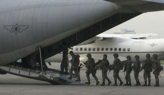 In this image made from video, marines board a transport plane in Manila, Philippines, Wednesday, June 1, 2017. A marine battalion left an air force base in Manila on deployment to the southern city of Marawi where ongoing violence has killed scores of people. (AP Photo)