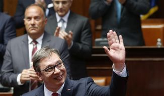Serbia's President Aleksandar Vucic waves during an inauguration ceremony, in Belgrade, Serbia, Wednesday, May 31, 2017. Vucic has been sworn in as Serbia's president, telling his supporters that he will work on peace and stability in the Balkans.(AP Photo/Darko Vojinovic)