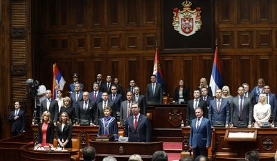 Serbia's newly re-elected President Aleksandar Vucic takes oath for a new term of office during an inauguration ceremony, in Belgrade, Serbia, Wednesday, May 31, 2017. Vucic has been sworn in as Serbia's president, telling his supporters that he will work on peace and stability in the Balkans. (AP Photo/Darko Vojinovic)
