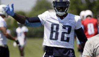 Tennessee Titans tight end Delanie Walker talks with teammates during the team's organized team activity at its NFL football training facility Wednesday, May 31, 2017, in Nashville, Tenn. (AP Photo/Mark Humphrey)
