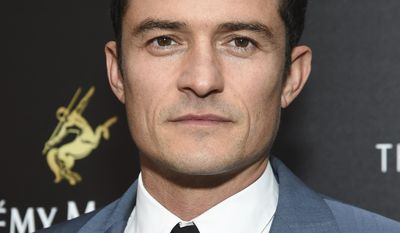 "FILE - In this May 23, 2017 file photo, actor Orlando Bloom attends a special screening of Walt Disney Studios' ""Pirates of the Caribbean: Dead Men Tell No Tales"", in New York. Bloom will serve as a presenter at this year's Tony Awards on June 11. (Photo by Evan Agostini/Invision/AP, FIle)"