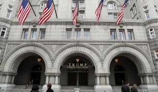In this photo taken Dec. 21, 2016, the Trump International Hotel in Washington. A Pennsylvania man has been arrested at the Trump International Hotel in Washington after police say they found a rifle and handgun in his car. (AP Photo/Alex Brandon) ** FILE **