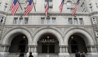 In this photo taken Dec. 21, 2016, the Trump International Hotel in Washington. A Pennsylvania man has been arrested at the Trump International Hotel in Washington after police say they found a rifle and handgun in his car. (AP Photo/Alex Brandon)