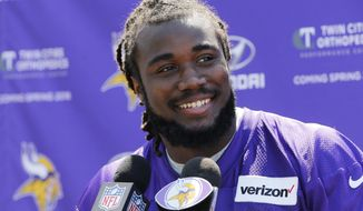 FILE - In this Friday, May 5, 2017 file photo, Minnesota Vikings rookie running back Dalvin Cook speaks to the media during the NFL football team rookies minicamp in Eden Prairie, Minn.  (AP Photo/Jim Mone, File)