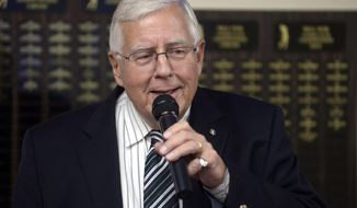FILE - In this Nov. 4, 2014, file photo, Sen. Mike Enzi, R-Wyo. speaks at the Bell Nob Golf Course Clubhouse in Gillette, Wyo., after winning re-election. Enzi has been released from the hospital after undergoing emergency gallbladder surgery over the weekend. (AP Photo/Tim Goessman, File)