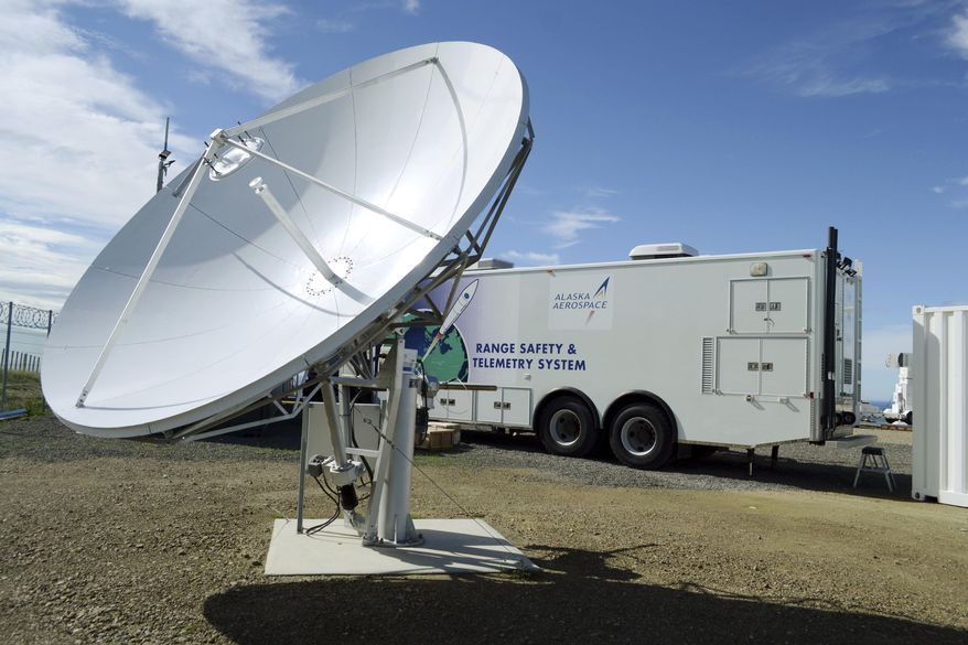 This undated photo provided by Alaska Aerospace Corp. shows the corporation's mobile operations center van and its satellite communications and data antenna in Mahia, New Zealand. The state-owned Alaska Aerospace Corp. has struggled for years to gain footing and profitability and suffered a major setback in 2014 when a rocket exploded after takeoff, damaging its launch facilities on Kodiak Island, Alaska. The corporation's work in New Zealand is an example of its effort to broaden its business, both in scope and beyond the confines of Alaska. (Alaska Aerospace Corp. via AP)
