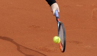 Britain's Andy Murray plays a shot against Russia's Andrey Kuznetsov during their first round match of the French Open tennis tournament at the Roland Garros stadium, in Paris, France. Tuesday, May 30, 2017. (AP Photo/Michel Euler)