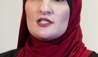 FILE - In this Jan. 9, 2017 file photo Linda Sarsour, co-chair of the Women's March on Washington, speaks during an interview in New York. The Muslim-American activist was scheduled to speak at a college commencement ceremony in New York City on Thursday, June 1, 2017, despite protests from critics who don't like her views on Israel. (AP Photo/Mark Lennihan, File)