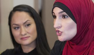 In this Jan. 9, 2017, file photo Linda Sarsour, right, and Carmen Perez, co-chairs of the Women's March on Washington, speak during an interview in New York. Sarsour was scheduled to speak at a college commencement ceremony in New York City on Thursday, June 1, 2017, despite protests from critics who don't like her views on Israel. (AP Photo/Mark Lennihan, File)