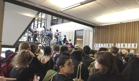 In this Wednesday, May 24, 2017, photo, after weeks of brewing racial tension on campus, hundreds of students at the Evergreen State College in Olympia, Wash., protest against the college administration and demanded change. (Lisa Pemberton/The Olympian via AP) ** FILE **