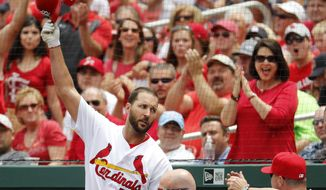 St. Louis Cardinals' Adam Wainwright tips his cap after hitting a two-run home run during the second inning of a baseball game against the Los Angeles Dodgers Thursday, June 1, 2017, in St. Louis. (AP Photo/Jeff Roberson)